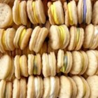 Swedish Cream Wafers - These are crisp and puffy sandwich cookies. The filling can be colored to match any occasion.
