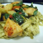 Spence's Pesto Chicken Pasta - A lovely and colorful pasta dish combines chicken with garlic, mushrooms, red peppers, artichoke hearts, spinach, and basil pesto. It's easy and quick, but looks and tastes elegant and special.