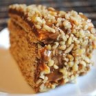 Torta De Hojas - Called 'Cake of Leaves,' this cake has 10 cookie layers sprinkled with brandy, then separated by walnuts and caramel. The caramel filling is made by boiling unopened cans of sweetened condensed milk until thickened.