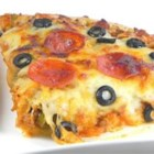 Beer Pizza - This is a very filling pizza that my husband loves. My mom and dad use to make it when I was young, and it was always a treat.