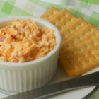 Southern Pimento Cheese - This wonderful version of pimento cheese can be used for grilled cheese sandwiches, as a spread for crackers, or served alongside your favorite fried green tomatoes.