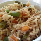 Vegetable Fried Rice - This dish combines the nutty flavor of brown rice with the fresh taste of bell peppers, baby peas, and other vegetables.