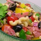 Greek Pasta Salad I - Taste the earthy flavors of the Mediterranean in every bite of this colorful summer salad. Tangy feta cheese, fresh mushrooms, tomatoes, onions, bell peppers and olives are tossed with spicy pepperoni and macaroni in an herb-infused vinaigrette.
