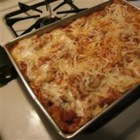 Buffalo Cheesy Chicken Lasagna - Lasagna noodles layered with a spicy spaghetti chicken and vegetable mixture and cheeses galore - ricotta, mozzarella and blue!
