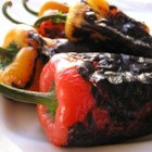"Easy Roasted Peppers - ""This is a really basic way to roast peppers for use in any recipe. Choose any color peppers you like, or use a variety of colors for a beautiful presentation.  After they are roasted you can add an oil and balsamic dressing, or fry in olive oil and garlic to serve with crusty bread."""