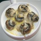 Easy Garlic Escargots - These tender escargots in mushroom caps are smothered with wine sauce and cheese.