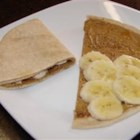 Banana Tortilla Snacks - For a quick snack, I buy the small tortilla shells in the refrigerated section in the store. I then spread peanut butter and or bananas/raisins on, fold and serve. In the morning, I have added a little honey on top.