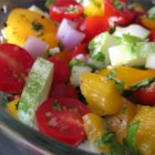 Fresh Tomato Salad -  This is a chopped salad with lots of tomatoes, onions, cucumbers and peppers. Fresh parsley, basil and garlic are folded in and just a hint of vinegar is splashed on to give it some bite. Chill and the flavors pop out. Six generous servings.