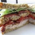 Lorraine's Club Sandwich - A triple-decked sandwich with bacon, turkey ham, lettuce and tomato.