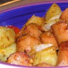 Roasted Creole Potatoes - Potatoes are roasted with andouille sausage in this delicious side dish!
