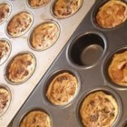Pecan Tarts -  Tiny tart shells are fitted with rounds of prepared pastry. Then the sweet, buttery pecan filling is spooned in and the tarts baked until set. Pipe a whipped cream rosette onto each, and sprinkle with crushed pecans.