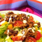 Amy's Barbecue Chicken Salad - Slices of grilled chicken are tossed with lettuce and Southwest-style ingredients, then served with a creamy barbeque sauce dressing.