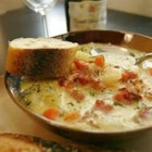 Ham Chowder - Ham and bacon lend a smoky taste, while cream gives rich texture to this ham and potato chowder, starring a supporting cast of leeks, onions, garlic, rosemary, and carrots.