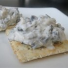 Olive Spread Snackers - Serve this smooth blend of black olives, walnuts and spices on toasted bread.