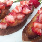 Strawberry Bruschetta - This is a delicious variation of the popular tomato based appetizer. The strawberries are warm and sweet and the sugar is caramelized and crunchy! Your guests will love it!