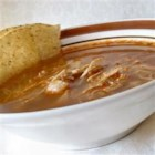 Easy Chicken Posole - This easy-to-make chicken and hominy soup is one of many great Mexican Christmas traditions, or simply delicious whenever you want to eat something warm and comforting. It's garnished with thinly sliced radishes, shredded lettuce, finely chopped onion, chopped cilantro, and lime wedges, which diners add to the soup as they please.