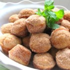 Donut Muffins - Little nutmeg-scented mini muffins are rolled in cinnamon sugar to make a treat that tastes like a donut and is fast to whip up. You can substitute butter for margarine.