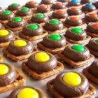 Chocolate Pretzels - Milk chocolate kisses are melted in pretzels and topped with a candy-coated chocolate for good measure.