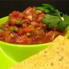 Sarah's Salsa - Canned tomatoes make this delicious and versatile salsa fast and easy. Adjust the ingredients to taste.