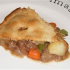 Good Old Meat Pie - A great deep dish meat pie made with potatoes, carrots and peas in a rich gravy. Lamb chicken or pork can be used in place of beef. A great recipe for leftover meat!