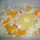 Hawaiian Coleslaw - This tasty slaw is perked up by the addition of mandarin oranges, crushed pineapple, ginger and nutmeg.