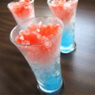 The Rocket - An icy cocktail with red, white, and blue layers looks like a rocket-shaped ice pop from the ice cream truck -- but this one is just for grown-ups. Lemon vodka, blue curacao, and raspberry liqueur give it color and taste.