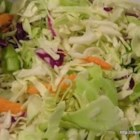 Grandma's Pepper Slaw - This recipe for sweet and sour cabbage slaw couldn't be simpler to make! Try it as a side dish for grilled burgers, hot dogs, roast pork, or beef.