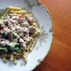 Sausage-Broccoli Pasta - Sausage, sun-dried tomatoes and chopped broccoli rabe cook in a creamy, cheesy sauce with corkscrew pasta.