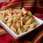 Buffalo Chicken Pasta Salad - Pasta, bell peppers, onion, and grilled chicken are tossed in a spicy mayo, blue cheese and wing sauce dressing.  This is a pasta salad for buffalo wing lovers.