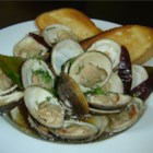 Clams in Oyster Sauce - Fresh clams are steamed in a sauce made with onion, ginger, garlic, and oyster sauce in this quick and tasty recipe.