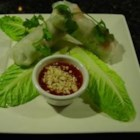 Thai Basil Rolls with Hoisin-Peanut Sauce - Shrimp and pork - layered with rice noodles, bean sprouts, and herbs - all rolled together in a fresh rice wrapper and served with a hoisin-peanut sauce for dipping. Great for an appetizer or lunch!