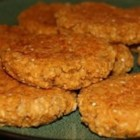 Vegan Baked Oatmeal Patties - Cooked oatmeal combined with onion, oil, spaghetti sauce, pecans, yeast and spices, and baked into hamburger-style patties. Excellent smothered in mushroom soup and sour cream.