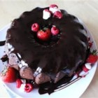 Red Wine Cake - This unusual cake is flavored with red wine, chocolate chips and powdered cocoa, and is spread with the frosting of your choice. Note: the more cocoa you add to the mix, the deeper the flavor of the cake.