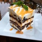 Easy Ice Cream Cake - Chocolate ice cream sandwich bars layered with chocolate fudge and frozen whipped topping with decorative chocolate sprinkles. Freeze for 1 hour, or until ready to serve.