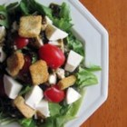 Arugula Caprese Salad - Peppery arugula adds a zingy bite to this fresh tomato and mozzarella salad.