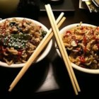 Asian Carryout Noodles - A fragrant stir-fry of onion, garlic, chicken, fresh ginger and bok choy is flavored with sesame oil, sherry, soy sauce and hoisin sauce and served over warm angel hair pasta. Sprinkle with sliced scallions and toasted sesame seeds.