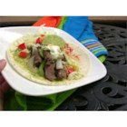 Ranch-Style Fajitas - Use your grill to make easy marinated flank steak with a ranch flavor. Roll in flour tortillas with grilled slices of onion and green pepper. No need to smoke up your kitchen when it's grilling season!