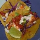 Baja-Style Fish Tacos - These fish tacos have a delicious tequila-lime-chili flavor and are topped with a crunchy ranchero coleslaw. They are very easy to make. Optional toppings can include black beans, jalapeno peppers, diced tomato, julienned carrots, and green onions.