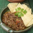 Slow Cooker Machaca - Beef and pork cooked in a slow cooker overnight creates the most tender Mexican meat filling you'll ever have.