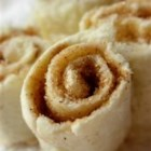 Yummy No-Bake Cinnamon Rolls for Kids - Slices of white bread are spread with butter and cinnamon sugar, then rolled and sliced into pinwheels, in an easy snack kids can make for themselves.