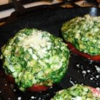 Ms B's Spinach-Topped Tomatoes - Fresh tomatoes, baked under a savory cornbread and cheese topping with spinach, is an old family recipe that earned a smiley face on the recipe card. Bright red tomatoes with the green spinach and golden cornbread make the dish a colorful addition to your table.