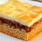 Pastitsio IV - A hearty casserole with beef, Parmesan cheese, tomatoes layered with sauce and macaroni.