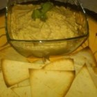 Robin's Best Ever Hummus - The best  hummus recipe I ever had. A simple authentic tasting hummus is served with toasted pita wedges brushed with olive oil and seasoned with rosemary. A beautiful dish that goes well on an appetizer buffet.