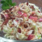 Blue Cheese Coleslaw - The addition of blue cheese salad dressing and cherry tomatoes makes this coleslaw a tasty variation on a timeless recipe.