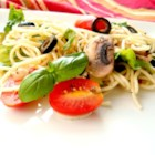 Sarah Rose's Dad's Made-Up Kind of a Salad Sort of Thing  - Spaghetti is the pasta backbone of this light salad featuring lots of sweet grape tomatoes, black olives, and sliced fresh mushrooms in a dressing with a Mediterranean vibe. It's perfect for a summer day.