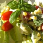 Avocado Corn Salad with Pine Nuts - Crisp romaine lettuce, kernels of tender corn, avocado slices, and cherry tomatoes are dressed with Caesar salad dressing, and sprinkled with pine nuts. Enjoy!