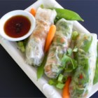 Thai Chicken Spring Rolls - Lightly pan-fried snow peas, green onions, and bean sprouts work with cilantro, carrots, and watercress to fill rice-paper rolls for a light, delicious treat.