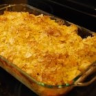 Yummy Tater Tot Casserole - This casserole uses frozen tater tots with canned cream of mushroom soup and is topped with sour cream-and-onion potato chips.