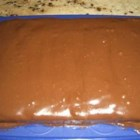 Peanut Butter and Chocolate Cake II - If you like chocolate and peanut butter you will love this cake. A chocolate sheet cake is spread with peanut butter, and then topped with chocolate frosting.