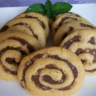 Date Nut Pinwheel Cookies II - Buttery cookies with a pecan-cinnamon swirl filling are easy to make and a hit with kids of all ages. The recipe makes three rolls of dough, which can be frozen until ready to bake.